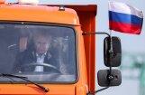 ВИДЕО: Путин за рулем