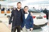 Foto: Kopā ar 'Dinamo Rīga' hokejistiem BMW salonā prezentē jaunākos modeļus
