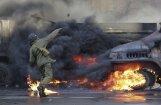 Ārzemju mediji: 'liesmās' arī Ukrainas ekonomika