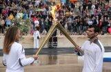 Olimpiskā lāpa nodota Londonas Olimpisko spēļu organizatoriem