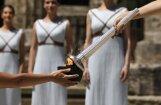Senajā Olimpijā iededz Phjončhanas spēļu olimpisko uguni