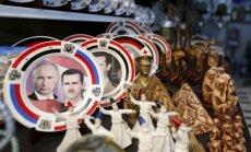 Foto: Asads un Putins kļūst par Damaskas suvenīru zvaigznēm