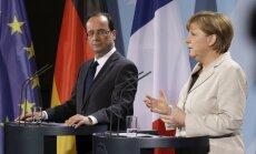 Merkele un Olānds brīdina Krieviju par jaunām sankcijām, ja Ukrainas prezidenta vēlēšanas izgāzīsies