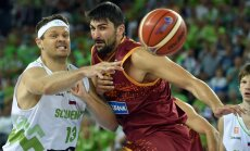 Slovenia s forward Miha Zupan (L) vies with Macedonia s guard Vojdan Stojanovski