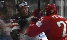 Oleg Yevenko of Belarus in action against Tyson Barrie of Canada
