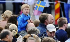 19.06.2010. A boy with a Swedish flag is seen among people gathering outside the Royal Palace in Stockholm, Sweden, 19 June 2010, prior to the wedding of Swedish Crown Princess Victoria and Daniel Westling. The wedding ceremony will take place in Stockhol