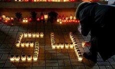 Foto: Zolitūdes traģēdijas piemiņas pasākumā pulcējušies vairāk nekā 200 cilvēki