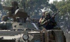 Krievijas karaspēks ieņēmis Novoazovsku, ziņo militāristi