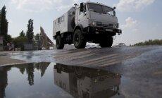 Машины российского гумконвоя начали разгружать в Луганске