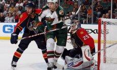 Karlis Skrastins and goaltender Tomas Vokoun Florida Panthers against Colton Gillies