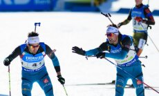 France Simon Desthieux touches his teammate Martin Fourcade