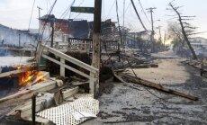 ASV austrumkrastu sasniedz ciklons 'Sendija', izraisot plūdus un 18 cilvēku nāvi; Kvīnsā plosās ugunsgrēks (14:36)