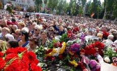 Foto: Doņeckā iespaidīgā bēru ceremonijā izvada uzspridzināto Zaharčenko