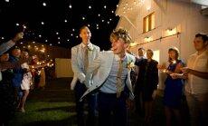 Foto: Atlēti kļūst par pirmo laimīgi precēto Austrālijas geju pāri