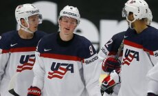 Jack Eichel (№9) celebrates with Mike Reilly (L) and Seth Jones scoring a goal against Slovenia