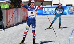 Johannes Thingnes Boe celebrates over Quentin Fillon Maillet