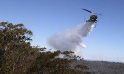 Литовская армия отправляет вертолет для тушения пожара в Латвии