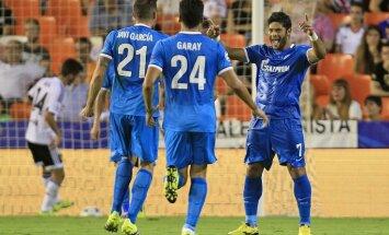 Zenit s Hulk, right, celebrates with teammates Ezequiel Garay, center, and Javi Garcia,