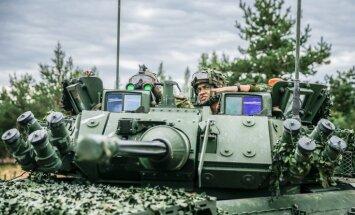 Foto: Kā karavīri trenējās NATO kaujas grupas sertifikācijas mācībās