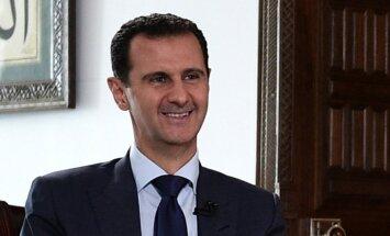 Ринкевич негодует: Мамыкин побывал в Сирии и вручил подарок Асаду