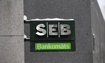 """Банкоматы SEB и DNB """"поссорились"""": клиентам придется платить за снятие наличных в чужом банкомате"""