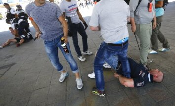 Poland fans are detained by police at Marseille