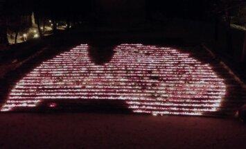 Video no putna lidojuma: Latvijas kontūra sveču liesmiņās