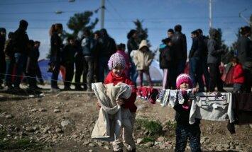 Коалиция: нет причин прекращать прием Латвией беженцев