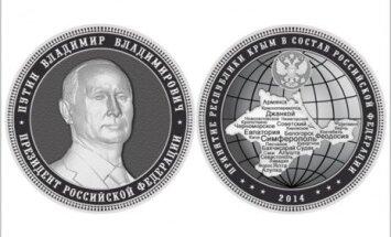 В России отчеканят килограммовые монеты с Крымом и портретом Путина