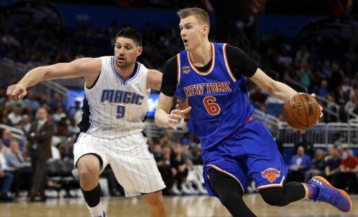 New York Knicks forward Kristaps Porzingis (6) drives past Orlando Magic center Nikola Vucevic