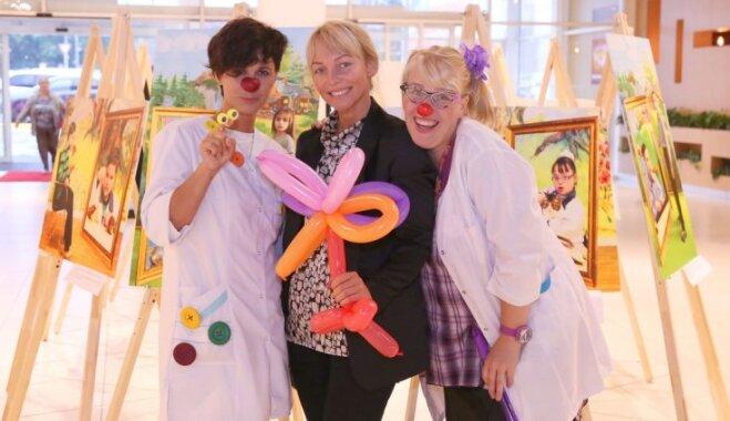 Universālveikalā 'Elkor Plaza' atklāta fotoizstāde 'Īpašo bērnu sapņi'