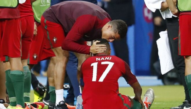 Portugal s Cristiano Ronaldo speaks to Nani