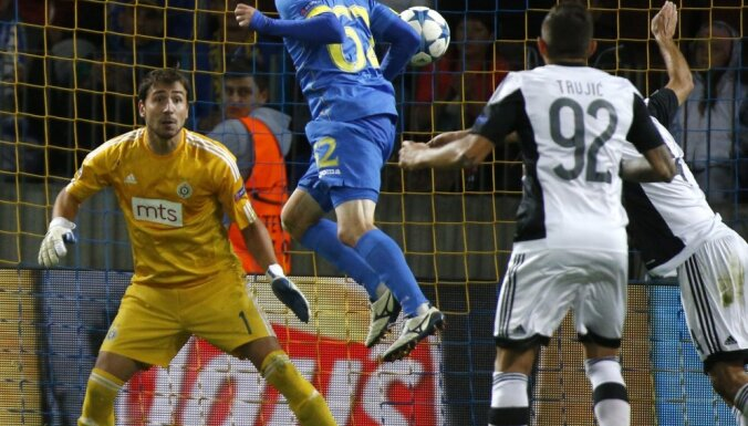 BATE's Mikhail Gordeichuk, center, scores against Partizan Belgrade