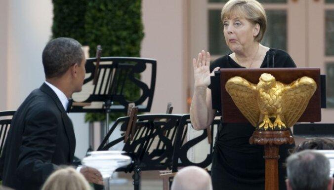 Меркель и Обама обсудили отношения в ресторане