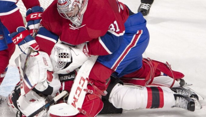 Montreal Canadiens Carey Price punches New Jersey Devils Kyle Palmieri