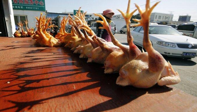 Foto: Āzijas 'slapjie tirgi', no kādiem nākuši koronavīrusi