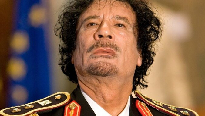 """Ливийский бизнесмен: Саркози получил от Каддафи """"три чемодана денег"""""""