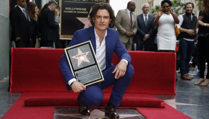 ФОТО: Орландо Блум открыл свою звезду на Аллее славы вместе с сыном
