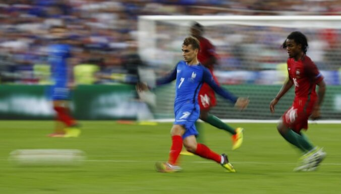 France s Antoine Griezmann in action with Portugal s Renato Sanches