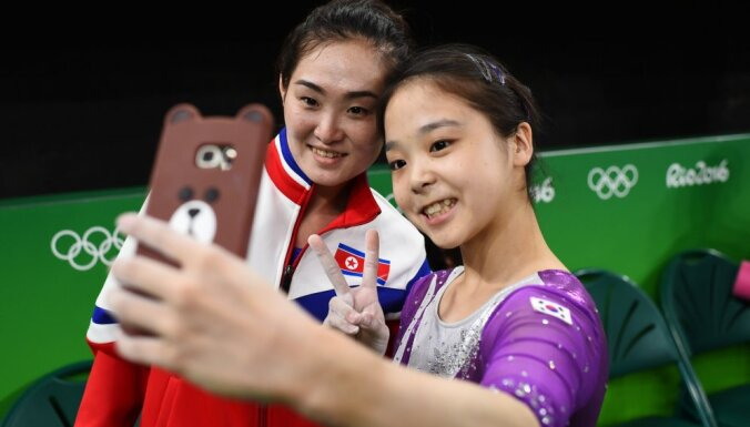 Lee Goim (KOR) of South Korea (R) takes a selfie picture with Hong Un Jong (PRK) of North Korea.