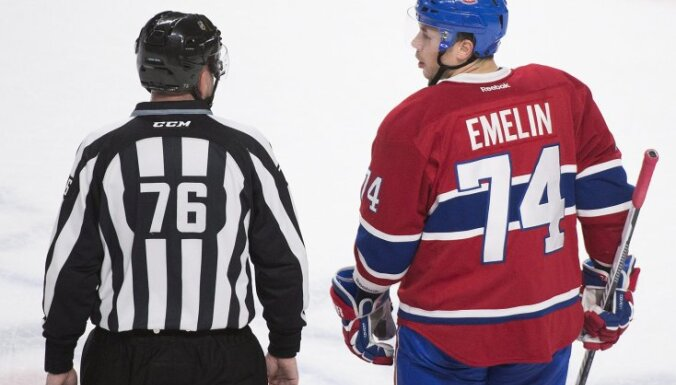 Montreal Canadiens defender Alexei Emelin with linesman Michel Cormier
