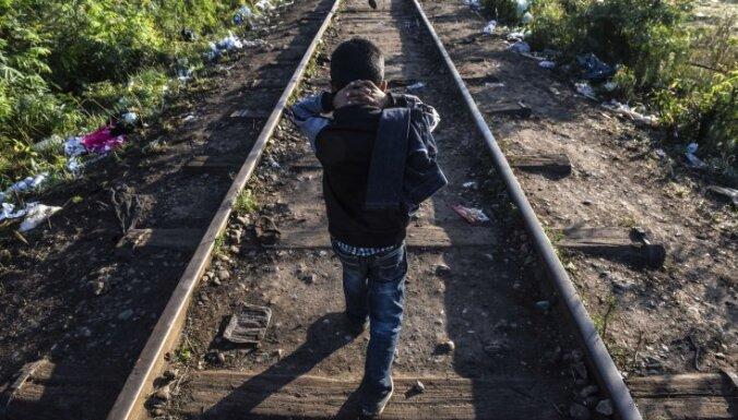Опрос: латыши более активно возражают против приема беженцев