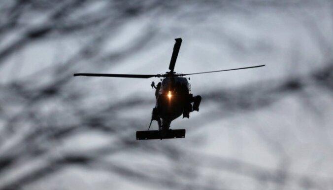 С помощью военного вертолета спасли заблудившегося в лесу человека