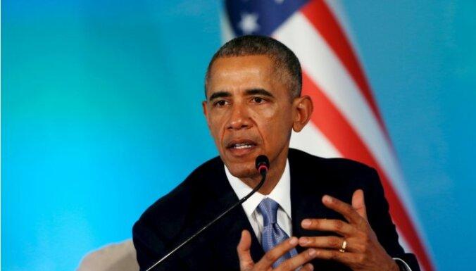 Обама после бойни в Колорадо вновь призвал ограничить доступность оружия