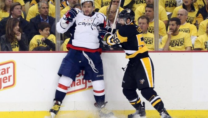 Pittsburgh Penguins Kris Letang checks Washington Capitals Alex Ovechkin