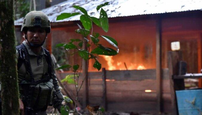 Foto: Kolumbijas džungļos iznīcina 104 narkotiku laboratorijas