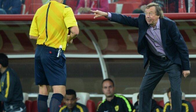 Referee Mikhail Volkov and Anzhi head coach Yuri Syomin