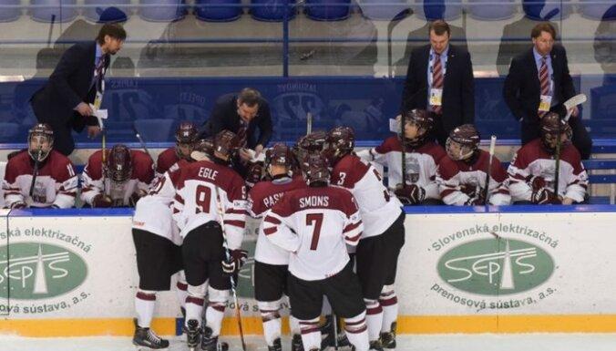 Latvia's U-18 players around head coach Igors Smirnovs 2017 IIHF World Championship
