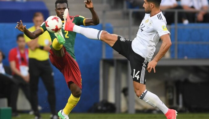 Cameroon Ernest Mabouka and Germany Emre Can