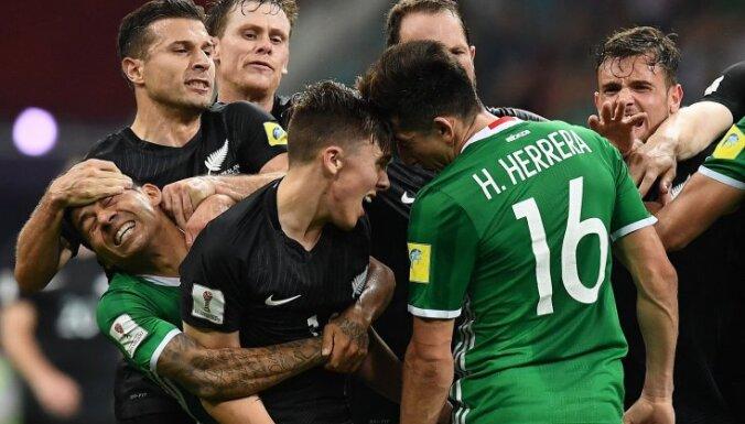 Mexico Javier Aquino, Hector Herrera fight with New Zealand s midfielder Ryan Thomas (C) Kosta Barbarouses
